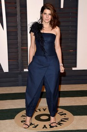 Marisa Tomei went the funky, ultra-modern route in a feather-accented navy jumpsuit by Azzaro Couture during the Vanity Fair Oscar party.