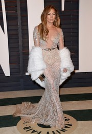 Jennifer Lopez brought the sex appeal to the Vanity Fair Oscar Party in a sheer embellished gown that left little to the imagination!