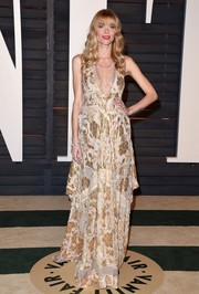 Jaime King showed off her boho maternity style with this flowy gold and white Altuzarra dress during the Vanity Fair Oscar party.