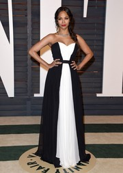 Zoe Saldana looked gorgeous in a simple gown with monochrome panels at the Vanity Fair Oscar Party.