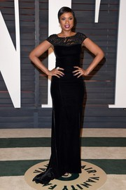 Jennifer Hudson was at her elegant best at the Vanity Fair Oscar party wearing a black lace-panel velvet gown by Lorena Sarbu.