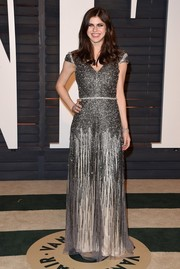 Alexandra Daddario glittered in a beaded and fringed silver gown during the Vanity Fair Oscar party.