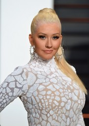 Christina Aguilera styled her platinum-blonde locks into a tight, high pony for the Vanity Fair Oscar party.