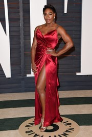 Serena Williams wrapped her curves Old Hollywood-style in a high-slit red Ines Di Santo gown for the Vanity Fair Oscar party.
