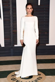 Natalie Portman looked simply impeccable in a long-sleeve white Dior column dress at the Vanity Fair Oscar party.