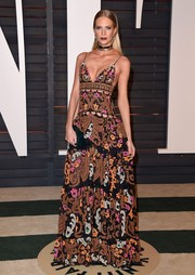 Poppy Delevingne was sexy-boho at the Vanity Fair Oscar party in an Emilio Pucci spaghetti-strap gown adorned all over with paisley appliques.