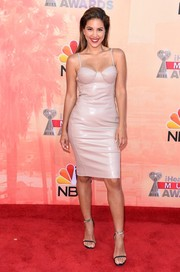 Liz Hernandez smoldered on the red carpet in a taupe leather corset dress at the iHeartRadio Music Awards.