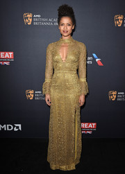 Gugu Mbatha-Raw looked radiant in a gold Burberry lace gown with a keyhole cutout during the 2016 BAFTA Britannia Awards.