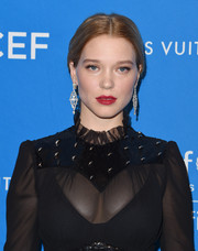 Lea Seydoux wore a simple, classic center-parted ponytail at the UNICEF Ball honoring David Beckham.