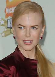 Nicole Kidman paired her sleek ponytail with elegant ruby dangle earrings.