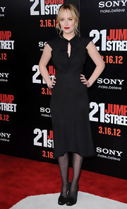 Dakota topped off her classic black dress with matching peep-toe pumps.