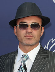 Julian McMahon topped off his dramatic Breeders' Cup ensemble with a pair of rectangular sunnies and a fedora.
