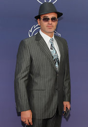 Julian was really workin' it at the Breeders' Cup in a pinstriped suit, matching fedora and aviator shades.