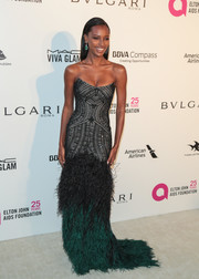 Jasmine Tookes got majorly glam in a Monique Lhuillier strapless gown with an Art Deco-inspired bodice and an ombre feather skirt at the Elton John AIDS Foundation Oscar-viewing party.