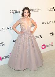 Laura Marano combined sexy with sweet in this plunging, floral-appliqued fit-and-flare gown by Tony Ward Couture at the Elton John AIDS Foundation Oscar-viewing party.