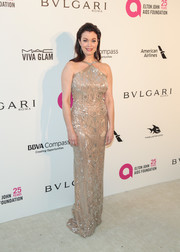 Bellamy Young looked perfectly polished in an embellished gold halter gown by Stephane Rolland Couture at the Elton John AIDS Foundation Oscar-viewing party.
