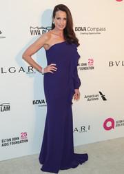 Andie MacDowell chose a purple Georges Chakra one-shoulder gown with a cascade of ruffles down the bodice for the Elton John AIDS Foundation Oscar-viewing party.