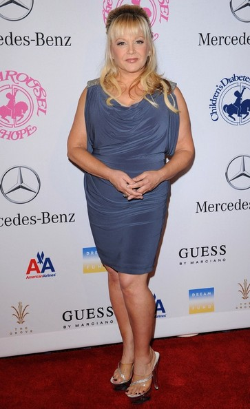 Charlene Tilton chose a pair of clear strapped sandals to go with her blue dress.