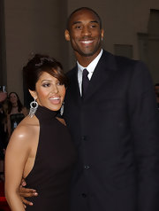 Vanessa Bryant glammed up her simple dress and messy updo with an ornate pair of diamond chandelier earrings.