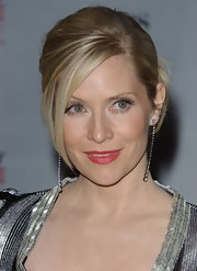 Emily Procter topped off her ultra-glam look with dramatic dangling diamond earrings.