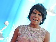 Tichina Arnold complemented her elegant dress with a funky layered razor cut and asymmetrical bangs at the NAACP Image Awards.