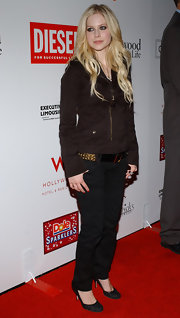 Avril Lavigne wore a gold studded black leather belt with her skater chic ensemble at the Hollywood Style Awards.