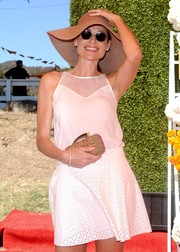 Minnie Driver complemented her casual outfit with a sophisticated animal-print clutch when she attended the Veuve Clicquot Polo Classic.