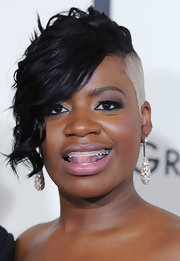 Fantasia Barrino wore a pair of diamond dangle earrings at the 50th Grammys.