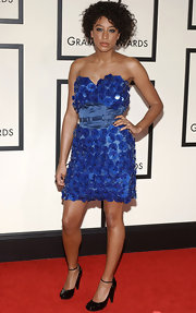 The singer completed her blue pailette dress with patent, ankle strap pumps.