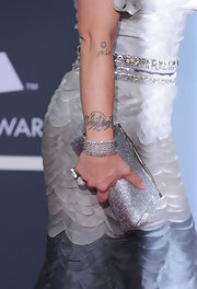 Rockstar Pink showed off her tattoos and her stunning gemstone inlaid clutch, which worked perfectly with her dress.