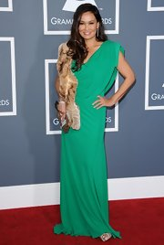 Tia Carrere finished off her emerald gown with a fur scarf for an Old Hollwood feel at the Grammys.
