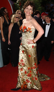 Jane Kaczmarek charmed in a gold strapless dress with orange flower appliques.