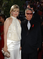 Diane Sawyer complemented her mod dress with an ultra-feminine gold satin clutch.