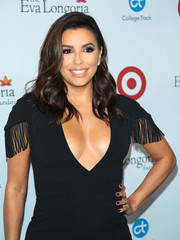 Eva Longoria wore her hair just below her shoulders in a side-parted wavy style during her Foundation's dinner.
