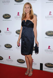 Jennifer Westfeldt paired gray T-strap sandals with her LBD for added sexiness.