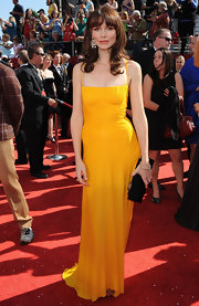 Saffron Burrows looked glamorously retro in a mustard evening gown with a ruched bodice.