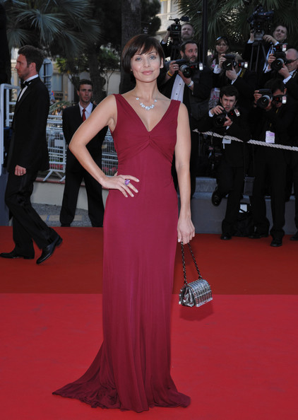 Natalie Imbruglia's red evening dress and beaded silver purse at the Cannes Film Festival were a super glam pairing.