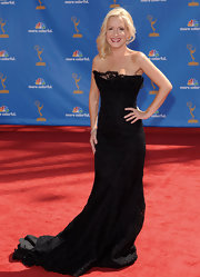 Angela Kinsey wore a strapless gown with softly fluted skirt, which highlights a delicately ruffled neckline all made of re-embroidered lace.