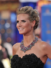 Heidi showed off her intricate french twist updo while hitting the Emmy Awards.