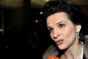 Juliette Binoche's dangling diamond earrings sparkled at the Berlin Film Festival.