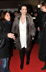 Juliette Binoche braved the cold in a luxurious fur coat at the Berlin Film Festival.