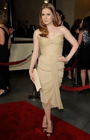 Amy Adams added shine to her sultry look with gold satin platform peep toes.