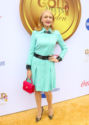 Patricia Clarkson contrasted her blue dress with a bright red purse by Ethan K.
