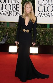 Kate Hudson looked lethal at the Golden Globes Awards in this black gold-clad gown with a high neck and keyhole.