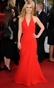Claire Danes invigorated the red carpet in this bright red wrap gown with a subtle beaded waist detail.