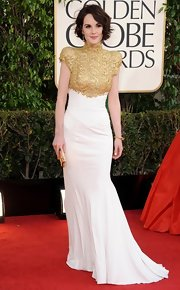 Michelle Dockery showed off her new short bob in this high-neck gold and white gown at the Golden Globe Awards.