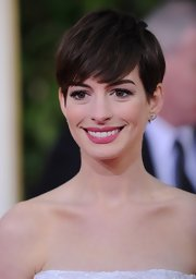 Anne Hathaway might have cried when she first chopped off her long brunette locks, but the star looked full of confidence with this effortless pixie cut at the 2013 Golden Globe Awards.