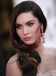 Megan Fox wore her caramel-highlighted hair parted sharply to the side and full of body at the 2013 Golden Globe Awards.