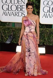Halle Berry looked hotter than ever on the red carpet in this sheer draped evening dress with intricate print.