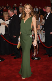 Celine Dion dazzled in an olive green James Galanos gown at the 2007 Academy Awards. She paired the Grecian-inspired dress with a diamond brooch and diamond bracelets.
